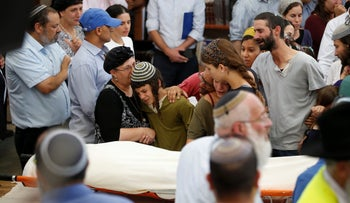 Relatives and friends of Israeli Michael Mark, who was killed during a Palestinian shooting attack mourns during his funeral in the West Bank Jewish settlement of Otniel, July 3, 2016.