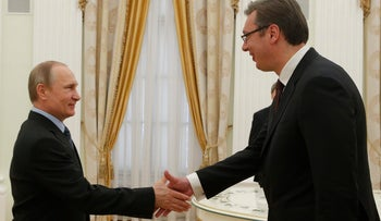 Vladimir Putin, left, greets Serbian Prime Minister and Progressive Party leader Aleksandar Vucic prior to their talks in Moscow, Russia, Thursday, May 26, 2016.