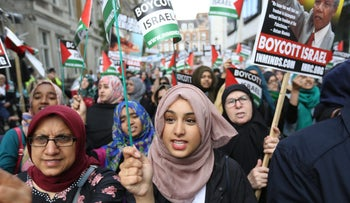 Pro-Palestinian supporters take part in a rally in central London, Sunday July 3, 2016, to commemorate Al-Quds Day.