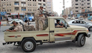 Yemeni army soldiers patrol a street in Mansoura district of Yemen's southern port city of Aden on March 30, 2016.