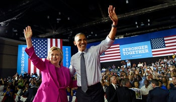 President Barack Obama and Democratic presidential candidate Hillary Clinton wave following a campaign event in Charlotte, N.C., July 5, 2016.