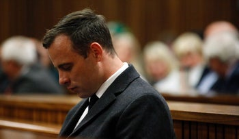 Paralympic athlete Oscar Pistorius looks on during the hearing in his murder trial at the High Court in Pretoria, on July 6, 2016.