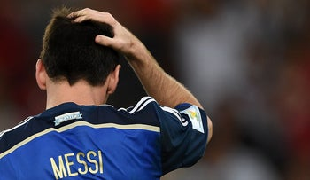 This file photo taken on July 13, 2014 shows Argentina's forward and captain Lionel Messi gesturing after his team lost the 2014 FIFA World Cup final football in Rio de Janeiro on July 13, 2014.