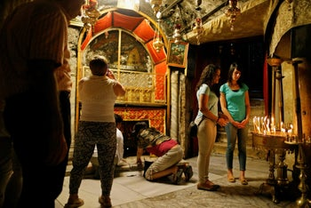 Visitors inside the basilica of the Church of the Nativity in Bethlehem.