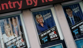 Posters of Fox News personalities including Gretchen Carlson, (C) who was recently fired from Fox News and who has filed a sexual harassment lawsuit against Fox News Chairman and CEO Roger Ailes.