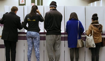 Voters cast ballots at a polling station in Sydney on July 2, 2016.