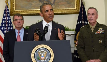 President Barack Obama, flanked by Defense Secretary Ash Carter, left, and Joint Chiefs Chairman Gen. Joseph Dunford, makes a statement on Afghanistan from the Roosevelt Room of the White House in Washington, Wednesday, July 6, 2016.