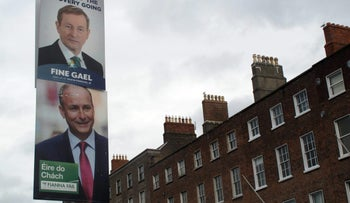 Rival election posters for Fine Gael leader Enda Kenny and Fianna Fail leader Micheal Martin as they adorn a lamp post in Dublin, Feb. 5, 2016.
