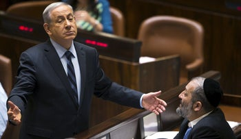 Benjamin Netanyahu and Arye Dery in the Knesset in 2015.