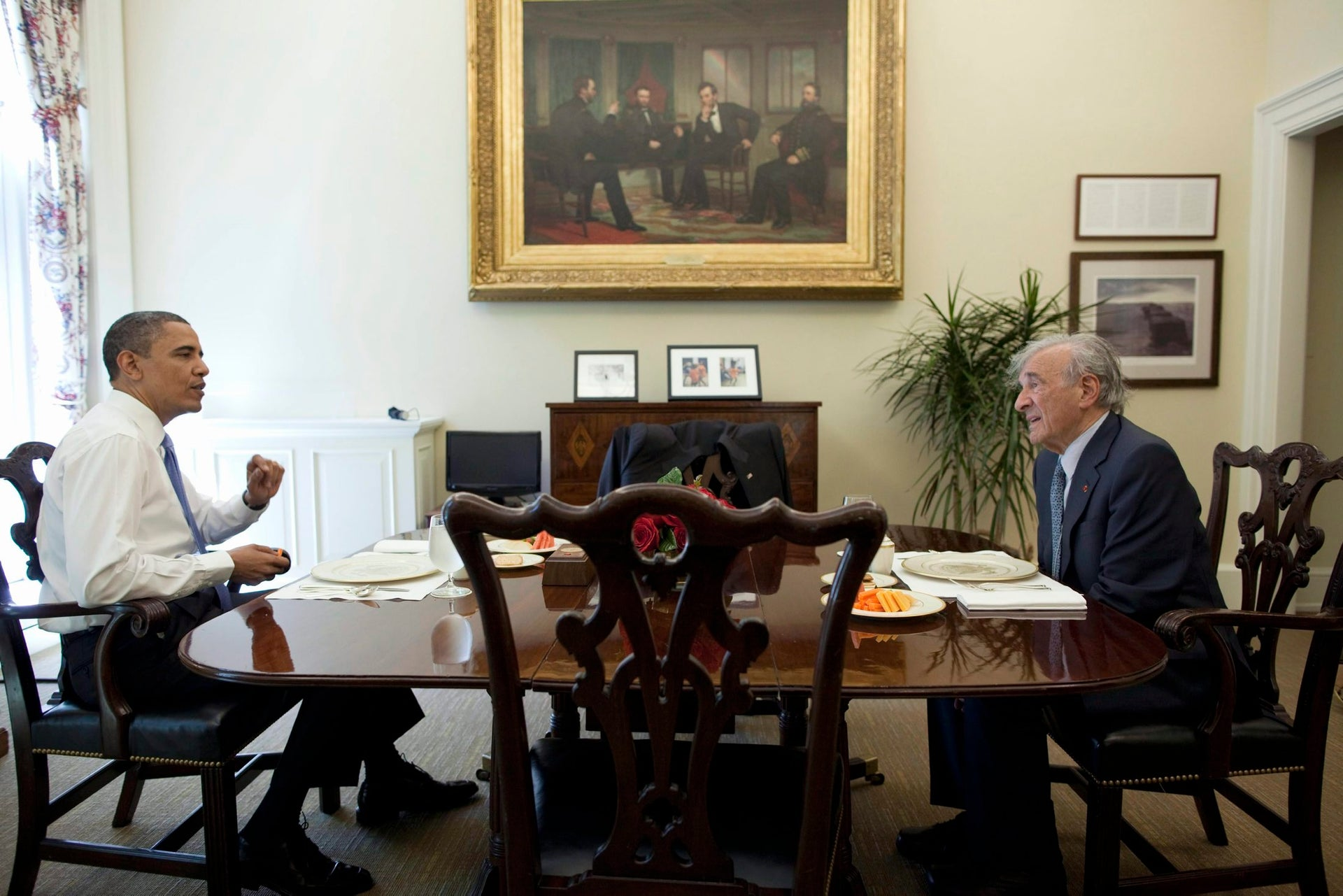 President Barack Obama has lunch with Elie Wiesel in the Oval Office Private Dining Room, May 4, 2010.