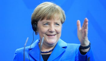 Angela Merkel, Germany's chancellor, gestures during a news conference at the Chancellery in Berlin, Germany, October 23, 2015.