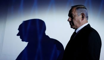 A profile shot of Prime Minister Benjamin Netanyahu at the 2016 Genesis Prize award-ceremony in Jerusalem, June 23, 2016. He is wearing a dark suit, white shirt and dark tie.