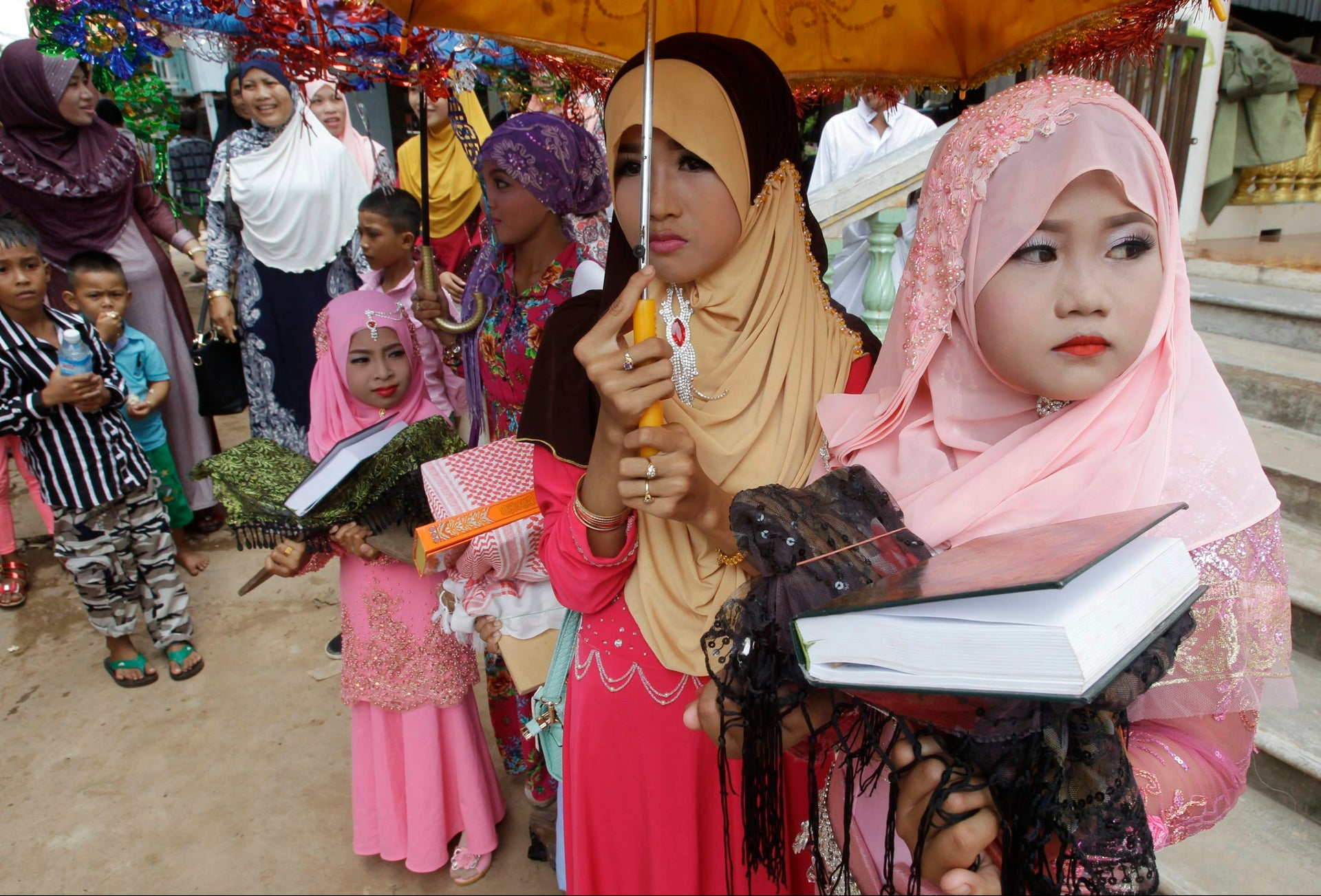 Muslims participate in Id al-Fitr prayers along the Mekong river of Tanong, northeast of Phnom Penh, Cambodia, Wednesday, July 6, 2016.