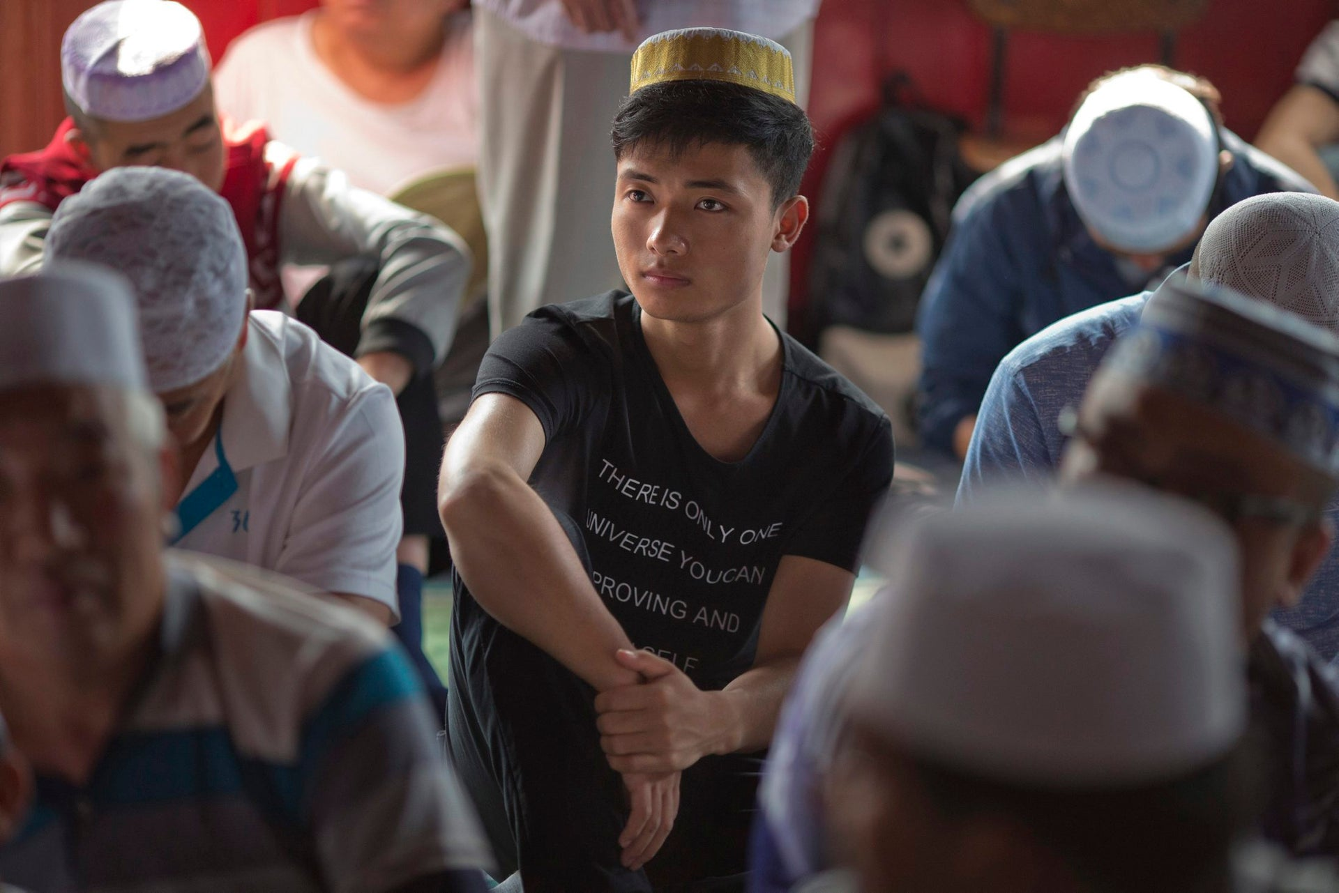 A Chinese Muslim man waits for Id al-Fitr prayers to begin at the Niujie mosque, the oldest and largest mosque in Beijing, China, Wednesday, July 6, 2016.