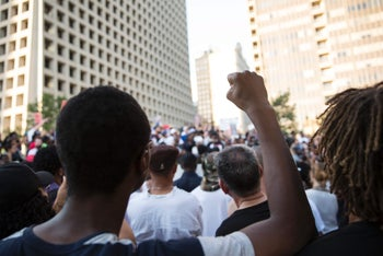 People rally in Dallas, Texas, on July 7, 2016 to protest the deaths of Alton Sterling and Philando Castile.