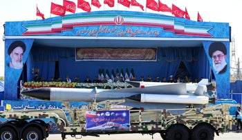 A missile is displayed by Iran's army in front of portraits of Ayatollah Ali Khamenei (R) and Ayatollah Khomeini (L) during a parade marking National Army Day outside Tehran, Iran, April 17, 2016.
