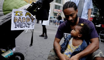 People take part in a protest against the killing of Alton Sterling, Philando Castile and in support of Black Lives Matter during a march along Manhattan's streets in New York July 8, 2016.