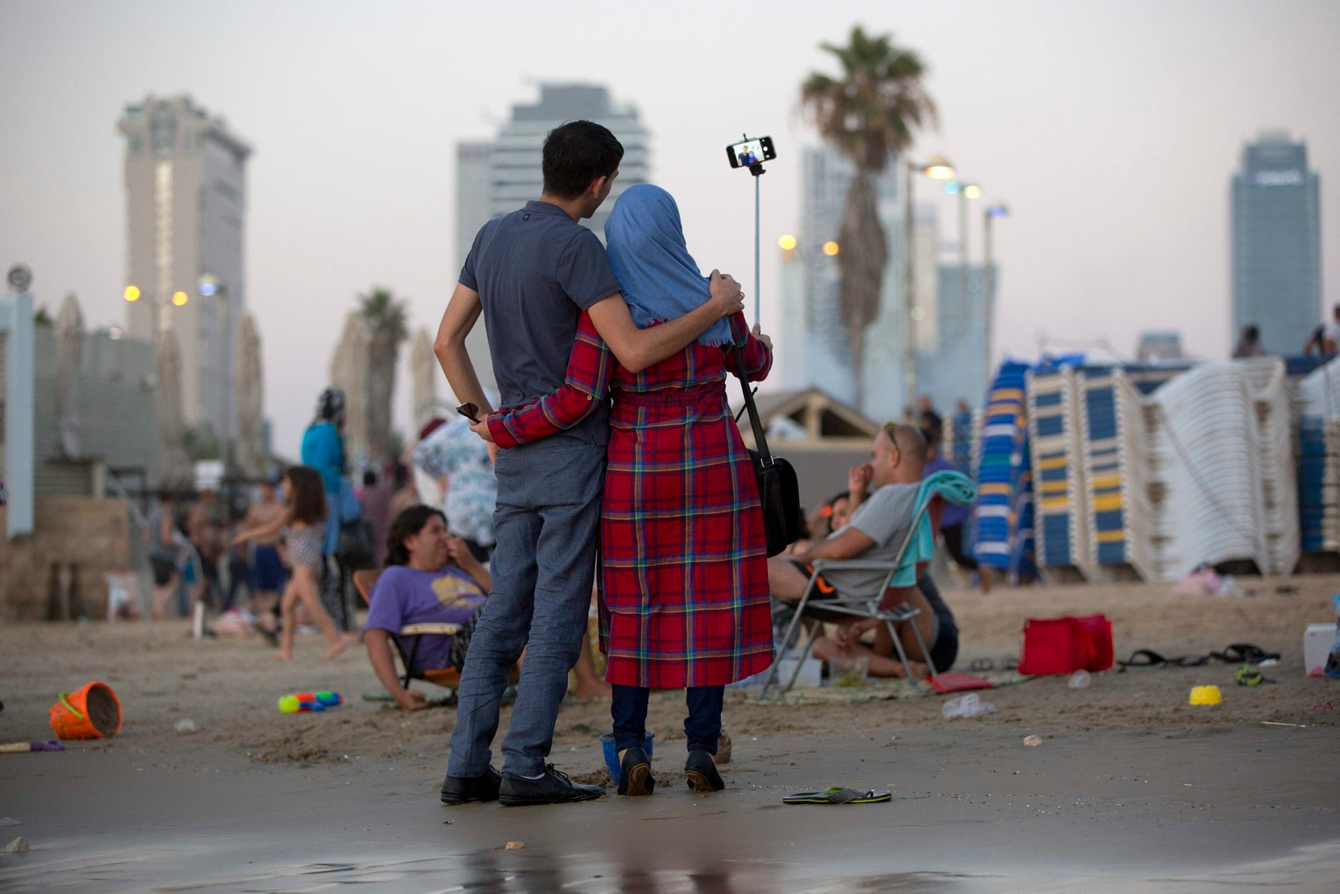 Israeli Arab couple take a selfie photo at the Mediterranean sea during the Eid al-Fitr holiday, in Tel Aviv, Israel, Friday, July 8, 2016. Eid al-Fitr marks the end of the Muslim holy fasting month of Ramadan.