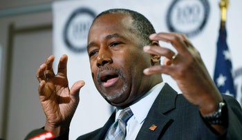Republican presidential candidate Ben Carson demonstrating how they packed all that grain into the pyramids, maybe, during a press conference, October 29, 2015.