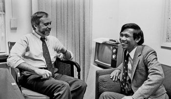 Schanberg, left, talks with Dith Pran at the New York Times office Jan. 15, 1980.