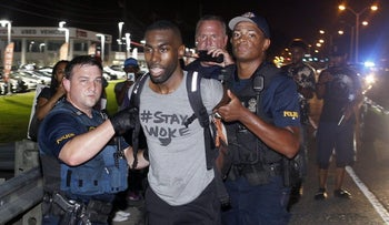 Police arrest activist DeRay McKesson during a protest along a highway that passes in front of the Baton Rogue Police Department headquarters in Louisiana July 9, 2016.
