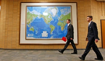 Two Mormon missionaries walk past a map of the world in a hallway at the Missionary Training Center in Provo, Utah in this Jan. 31, 2008 file photo (illustrative).