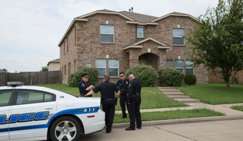 Police officers stand outside the home of Micah Johnson, where he practiced with explosives, in Mesquite, Texas July 9, 2016.