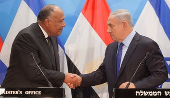 Prime Minister Benjamin Netanyahu shakes hands with Egypt's Sameh Shoukry in first official trip by an Egyptian foreign minister to Jerusalem in nine years. July 10, 2016.