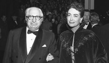 "Actress Joan Crawford on the arm of Louis B Mayer at the ""Torch Song"" movie premiere in Los Angeles, Calif., 19 November, 1953."
