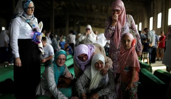 Muslim women cry near coffins of their relatives, newly identified victims of the 1995 Srebrenica massacre, Potocari, Bosnia and Herzegovina July 9, 2016.