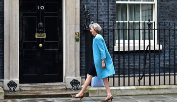 This file photo shows British Home Secretary Theresa May arriving at 10 Downing Street in central London.