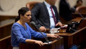 Justice Minister Ayelet Shaked addressing the Knesset plenum ahead of the vote on the NGO bill, July 12, 2016.