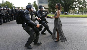 Protestor Ieshia Evans is detained by law enforcement near the headquarters of the Baton Rouge Police Department, Louisiana, U.S. July 9, 2016.