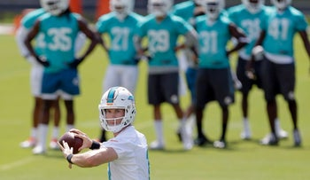 Miami Dolphins quarterback Ryan Tannehill prepares to pass during an NFL football practice Thursday, May 26, 2016, in Davie, Fla.