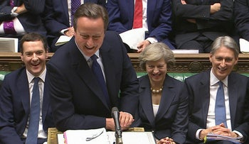 David Cameron, front, speaks during his final session of prime minister's questions at the House of Commons in London, July 13, 2016 before Theresa May becomes prime minister.