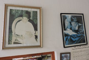 Faded photos of King Hassan II and Rabbi Menachem Mendel Schneerson on the wall of the Chabad facility in Casablanca.