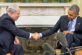 President Barack Obama shakes hands with Israeli Prime Minister Benjamin Netanyahu in the Oval Office of the White House in Washington, Monday, Nov. 9, 2015.