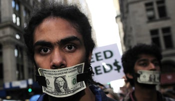 Members of Occupy Wall Street stage a protest near Wall Street in New York, on October 15, 2011.