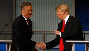 Jeb Bush and Donald Trump shake hands after the Republican presidential debate at the Milwaukee Theatre, Nov. 10, 2015, in Milwaukee.
