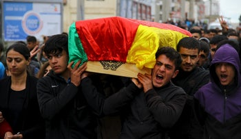 Mourners carry the coffin of Yakup Sinbag, a civilian killed in Silvan, Turkey during clashes with Kurdish militants. November 11, 2015.
