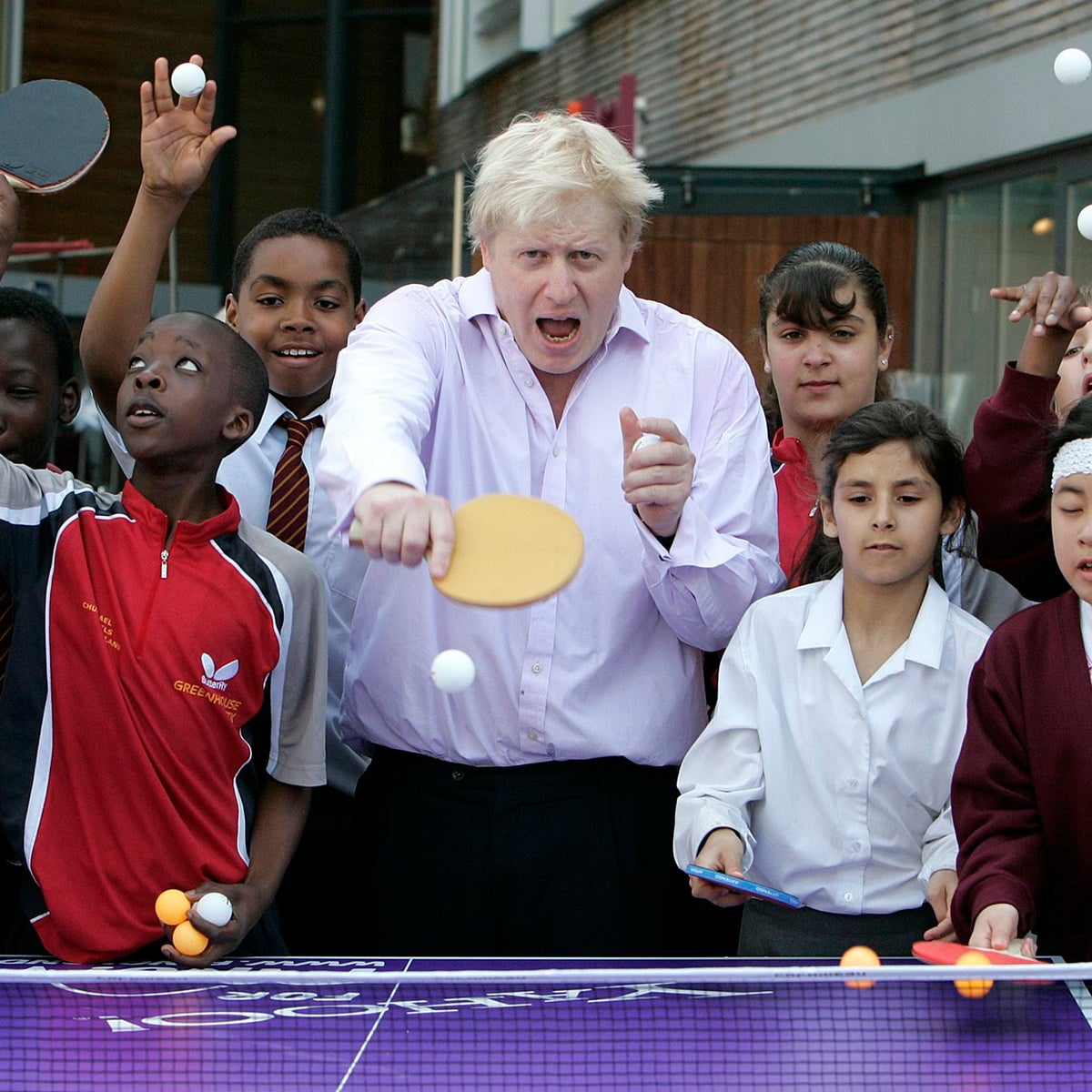 Boris Johnson plays a game of table tennis with pupils in London, U.K., June 25, 2010.
