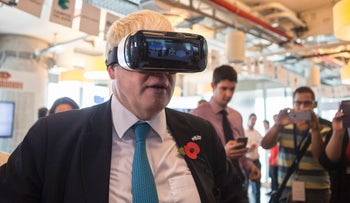 Boris Johnson wears virtual reality goggles during a visit to the Google offices in Tel Aviv, Israel, November 9, 2015.