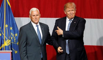 U.S. Republican presidential candidate Donald Trump and Indiana Governor Mike Pence wave to the crowd during a campaign stop in Westfield, Indiana, U.S., July 12, 2016.