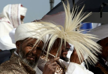 Member of the Ethiopian Jewish community in Israel dance during a ceremony marking the holiday of Sigd in Jerusalem November 11, 2015.