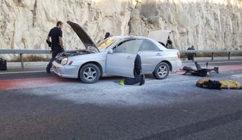 A car near Ma'aleh Adumim after a woman allegedly set off a gas canister in a terror attack, November 12, 2015.