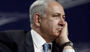 Netanyahu listens to a question as he participates in a forum hosted by the Center for American Progress in Washington, November 10, 2015.