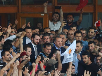 Turkish President Tayyip Erdogan is seen amid his supporters at the Ataturk Airport in Istanbul, Turkey July 16, 2016.