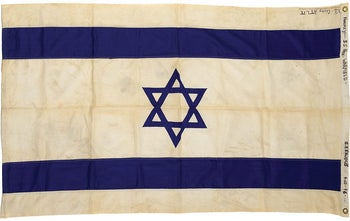 """The Israeli flag that flew on the """"Exodus"""" was sold at an auction."""