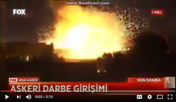 A screenshot of a Turkish news report filming a bomb hitting Turkey's Parliament building during an attempted coup on July 16, 2016.