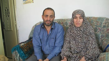 The parents of Dania Ershied, who was shot to death at a Hebron checkpoint on October 25, 2015. The parents sit on a sofa in their simple Hebron apartment.